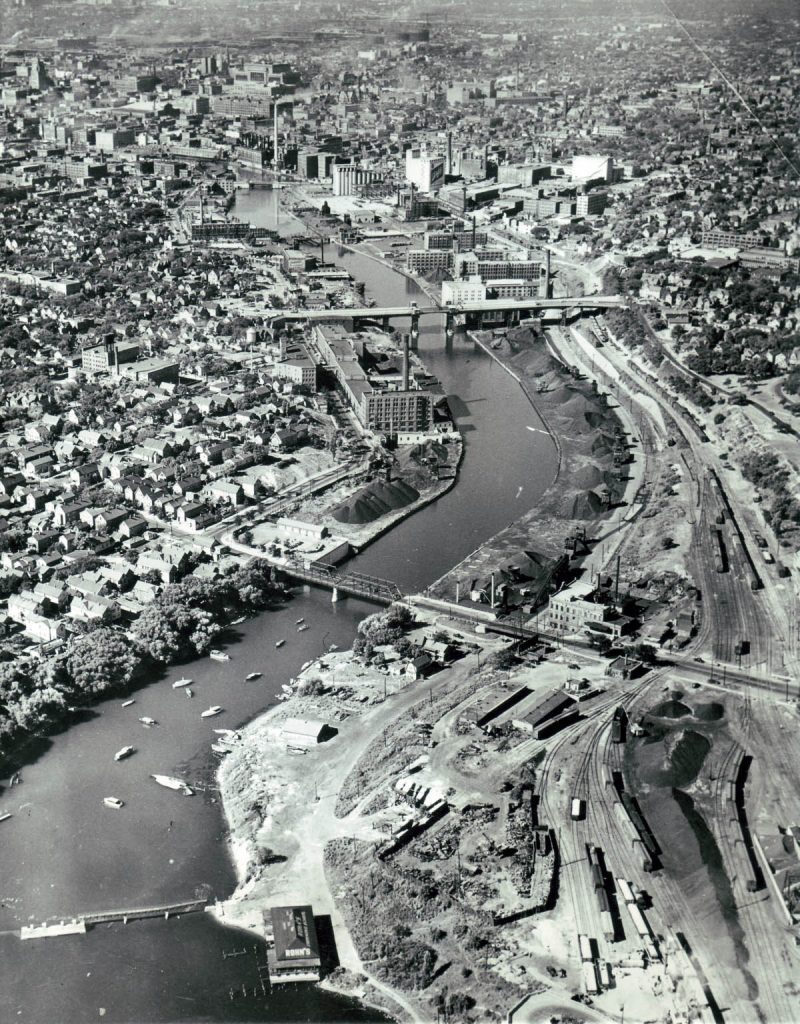 A black-and-white photo of the greenway showing the original railroad in 1948