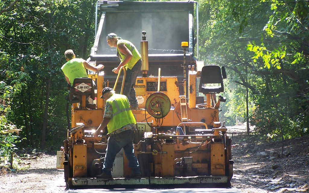 Workers pave the Beerline Trail with cement