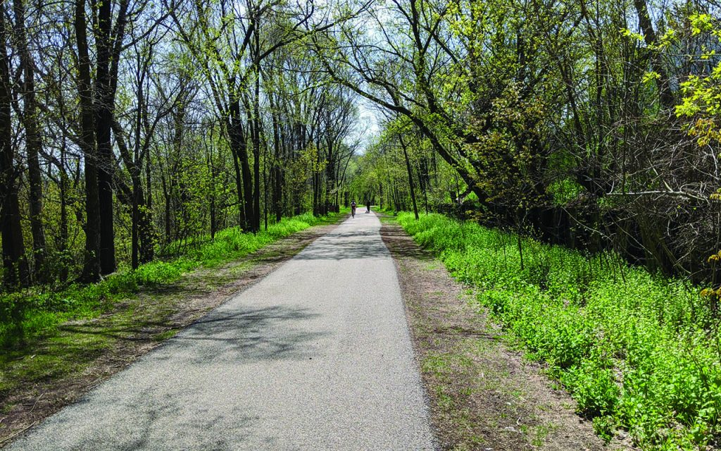 Bikers on the newly paved Beerline Trail